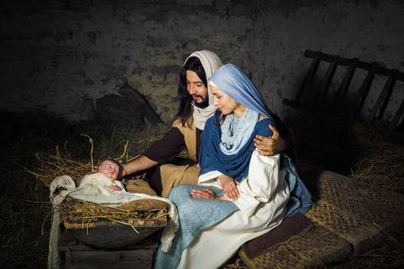 64485515-live-christmas-nativity-scene-in-an-old-barn-reenactment-play-with-authentic-costumes-the-baby-is-a-